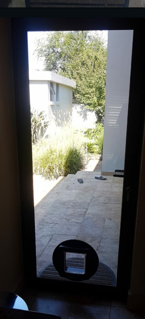 Single Hinge Door, White Aluminium, 6mm Clear Toughened Glass + Automated Doggy Door