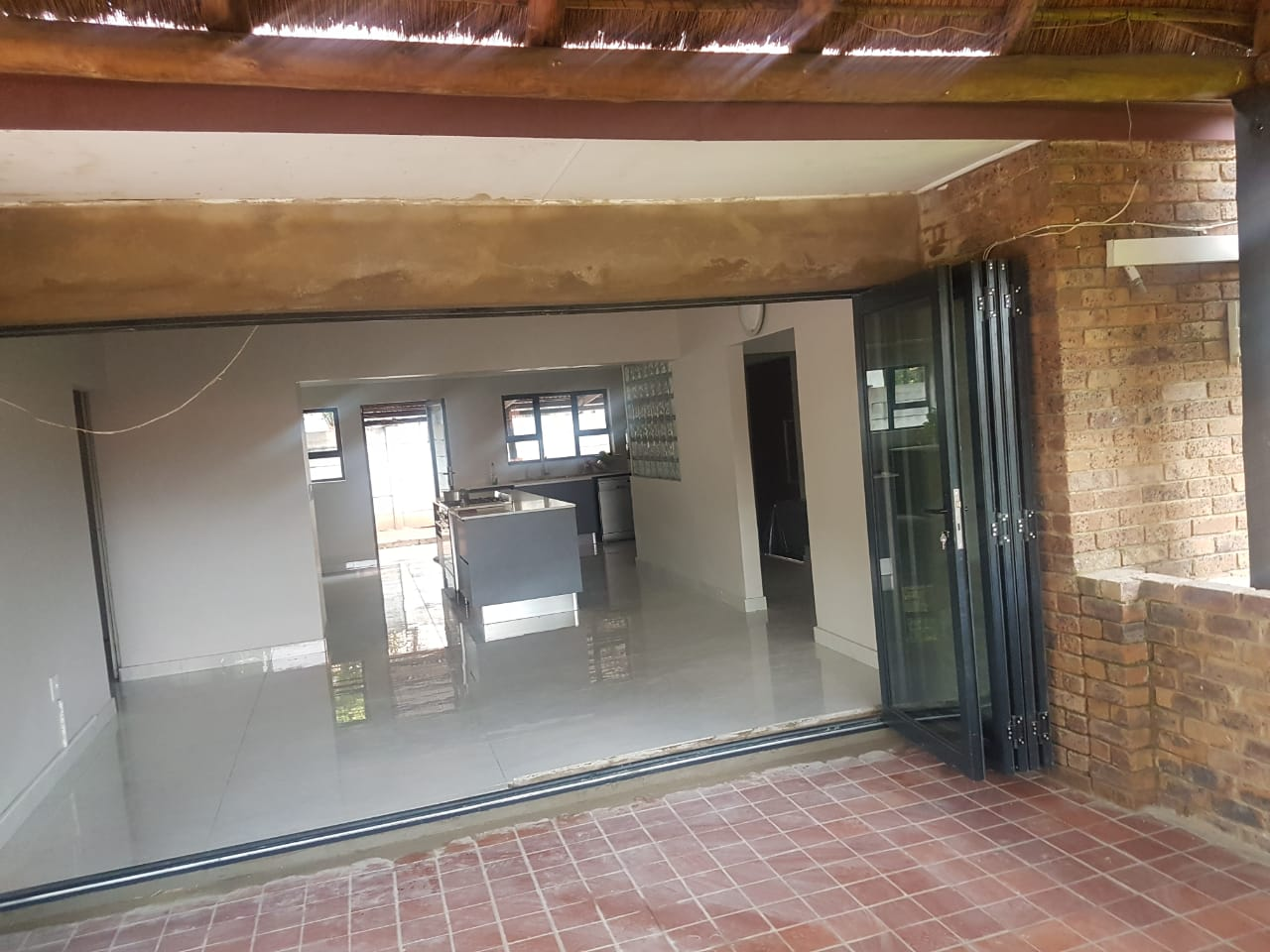 Completed Installation - Window, Door, and Wall all Removed, I-Beam Plastered and Finished Off for Client as Painting and Finishing is Not Done by All in One